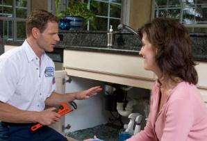 Keller plumbing technician consults with a customer